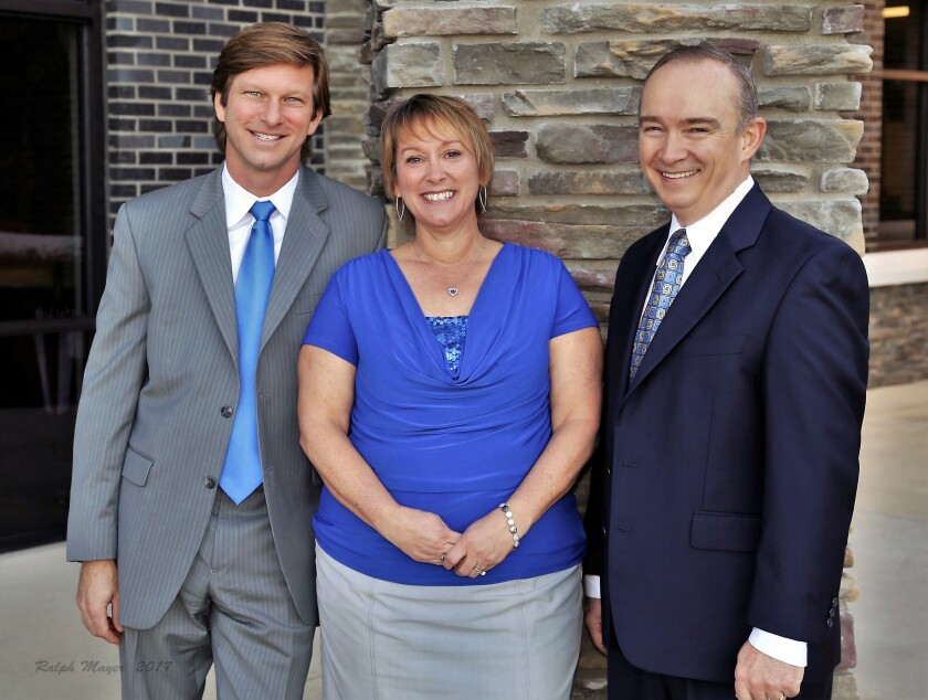 From left to right: Ameriprise advisor Heath Bartlett, client associates Andrea Hallas and Fred Johnson