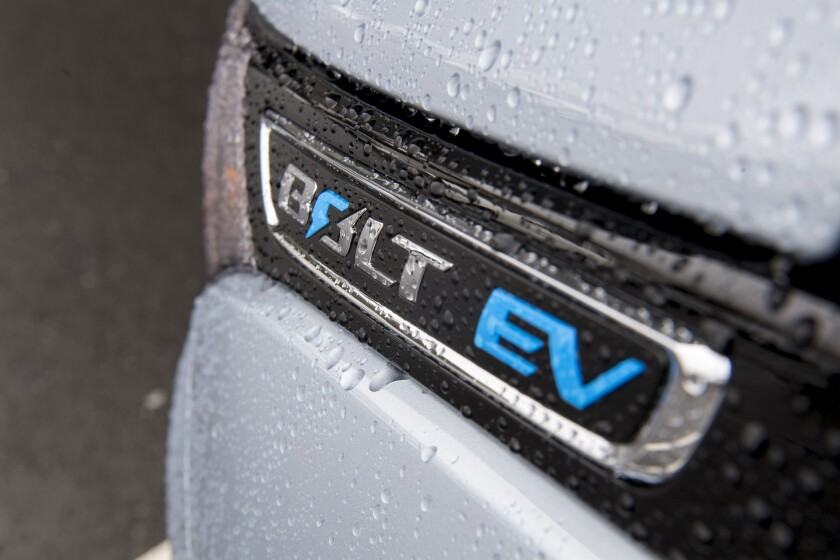 The badge for a General Motors Co. (GM) Chevrolet brand Bolt EV electric vehicle is displayed at the Stewart Chevrolet dealership in Colma, California, U.S., on Monday, Feb. 6, 2017. General Motors is scheduled to release earnings figures on Feb. 7. Photographer: David Paul Morris/Bloomberg