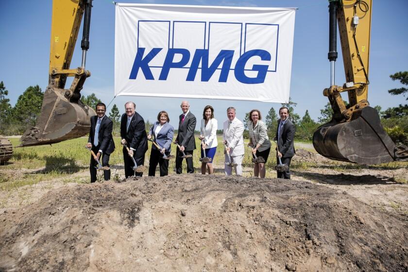 Florida Governor Rick Scott and KPMG CEO Lynn Doughtie break ground on KPMG's new training facility in Orlando