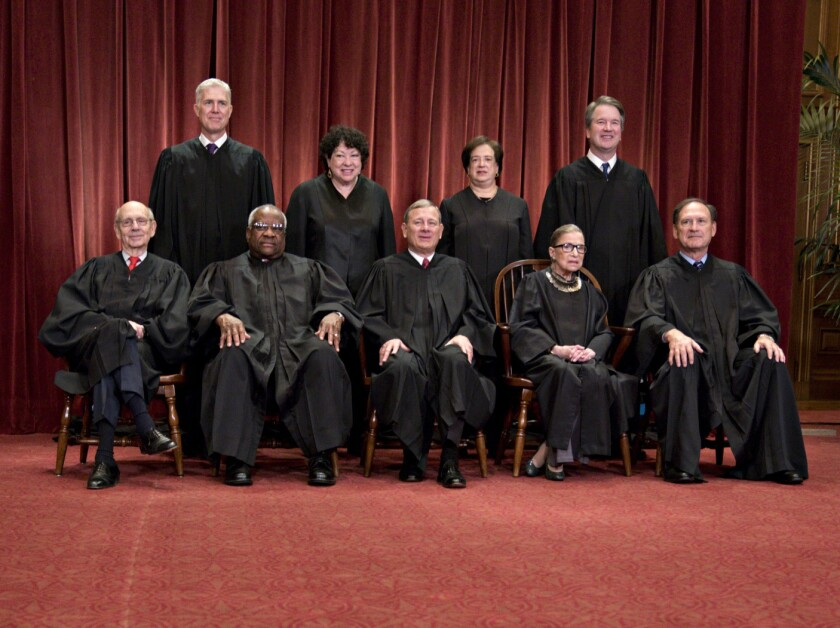 Justices of the U.S. Supreme Court pose during their formal group photograph in the East Conference Room of the Supreme Court in Washington, D.C. Seated from left: Associate Justice Stephen Breyer, Associate Justice Clarence Thomas, Chief Justice John Roberts, Associate Justice Ruth Bader Ginsburg and Associate Justice Samuel Alito Jr. Standing behind from left: Associate Justice Neil Gorsuch, Associate Justice Sonia Sotomayor, Associate Justice Elena Kagan and Associate Justice Brett Kavanaugh.