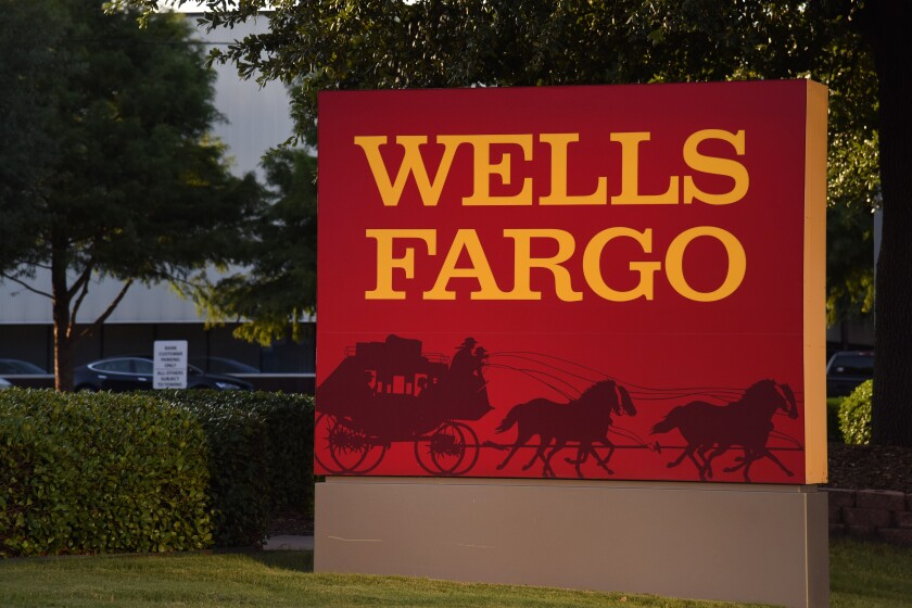 Wells Fargo signage displayed outside a bank branch in Dallas on Monday, July 10, 2017 Bloomberg News