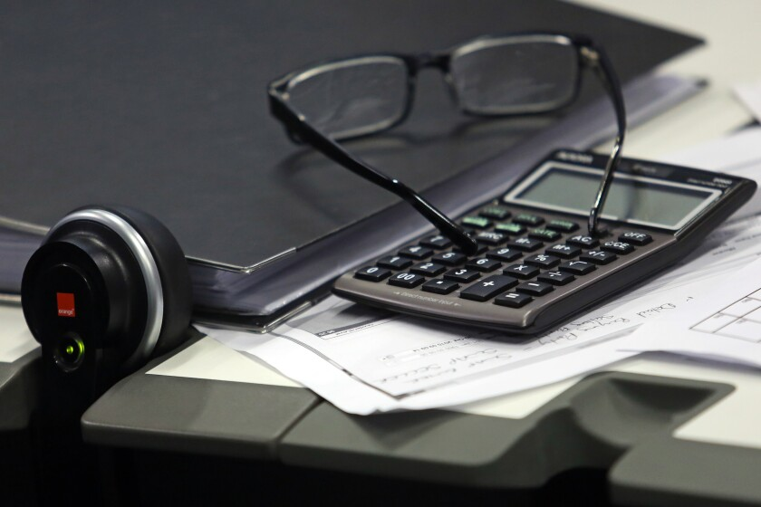 Calculator, glasses by Bloomberg News