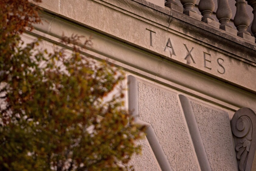"The word ""Taxes"" on the facade of the IRS headquarters in Washington, D.C."