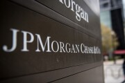 Signage stands on display outside the JPMorgan & Chase Tower in downtown Chicago, Illinois, U.S., on Saturday, Oct. 7, 2017.  AKA J.P. Morgan.