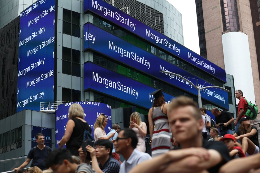 People sit across from Morgan Stanley headquarters in New York, U.S., on Thursday, July 12, 2018. Morgan Stanley is scheduled to release earnings figures on July 18. Photographer: Bess Adler/Bloomberg