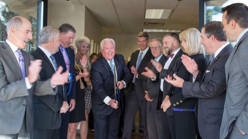 CEO Jim Allen cuts ribbon Hilliard Lyons - new branch Asheville, North Carolina