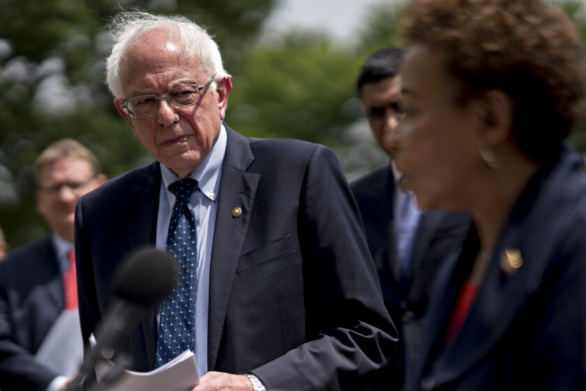 Senator Bernie Sanders, an independent from Vermont, listens as Representative Barbara Lee, a Democrat from California, right, speaks during a news conference introducing the Inclusive Prosperity Act on Capitol Hill in Washington, D.C.