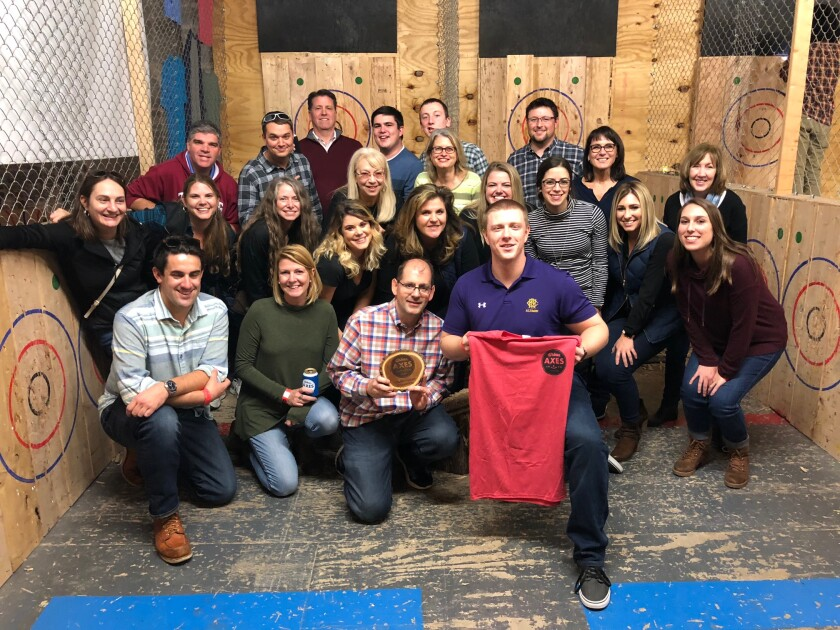 Staff from GMS Surgent at an axe-throwing event