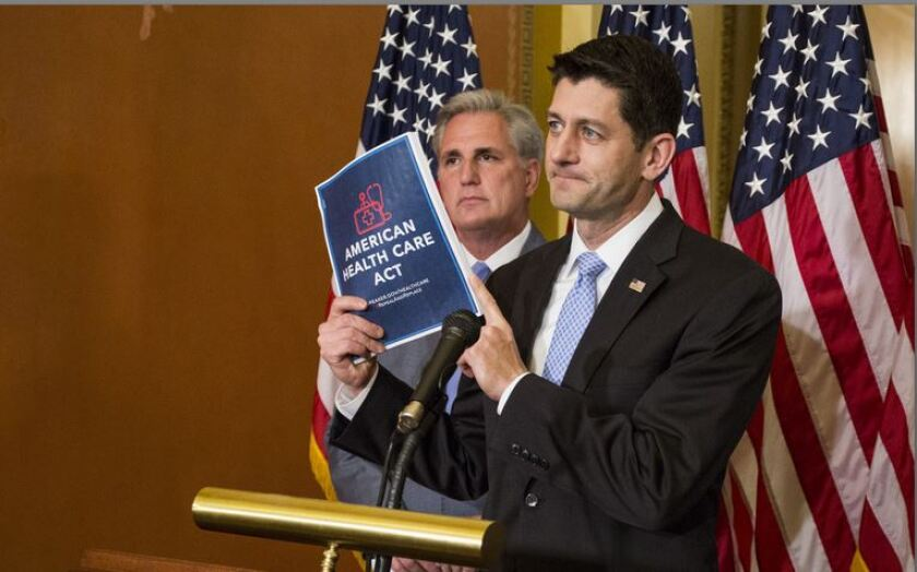 House Speaker Paul Ryan holding up a copy of the American Health Care Act, with House Majority Leader Kevin McCarthy