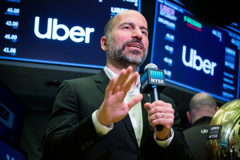 Dara Khosrowshahi, chief executive officer of Uber Technologies Inc., speaks on a webcast during the company's initial public offering (IPO) on the floor of the New York Stock Exchange (NYSE) in New York, U.S., on Friday, May 10, 2019. Uber fell in its trading debut, leaving the company's market value below its last private funding round. Photographer: Michael Nagle/Bloomberg