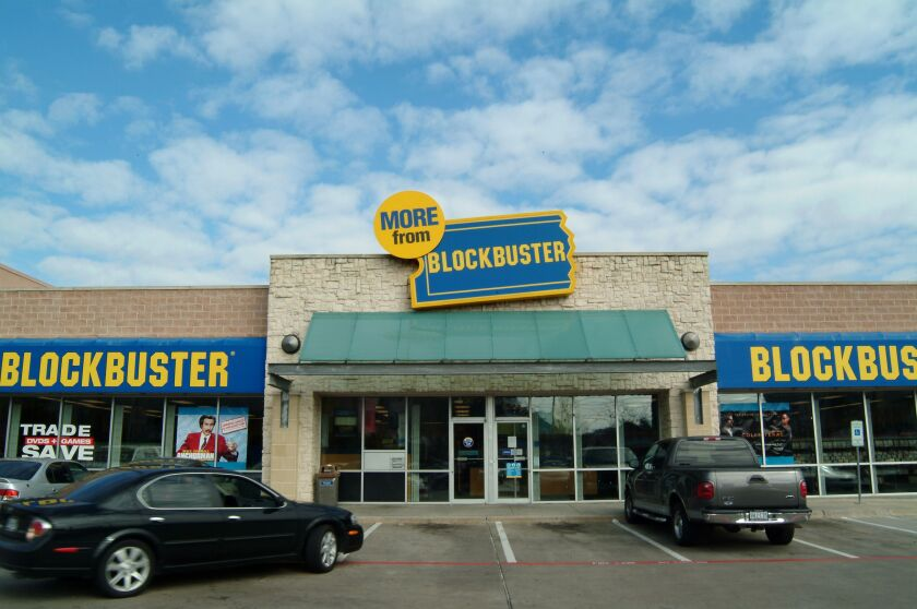 This is a Blockbuster video store in Dallas, Texas, December 28, 2004. Blockbuster Inc., the largest U.S. video store chain, threatened to make a $700 million hostile takeover offer for Hollywood Entertainment Corp. after failing to reach an agreement with an earlier bid. Photographer: Jason Janik/Bloomberg News