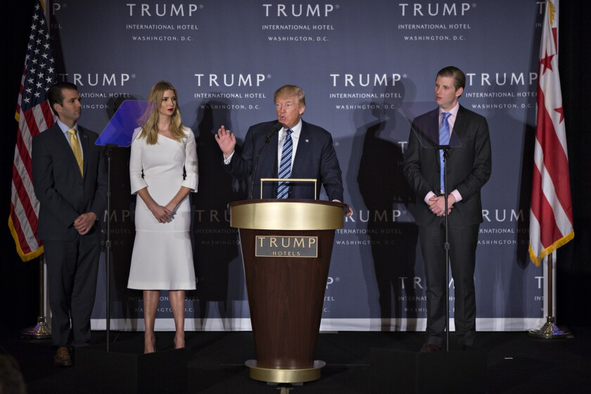 Donald Trump Jr., Ivanka Trump, Donald Trump and Eric Trump (left to right)  at the grand opening ceremony of the Trump International Hotel in Washington, D.C.