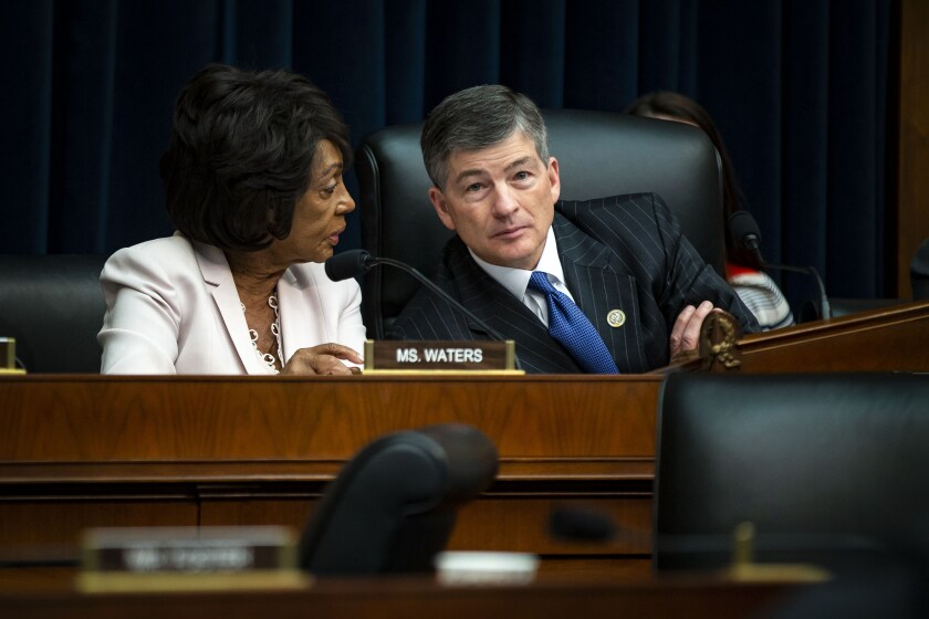 Maxine Waters, a Democrat from California and ranking member of the House Financial Services Committee, left, speaks with Representative Jeb Hensarling, a Republican from Texas and chairman of the House Financial Services Committee.