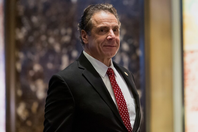 New York Governor Andrew Cuomo arrives in the lobby of Trump Tower on Jan. 18, 2017.