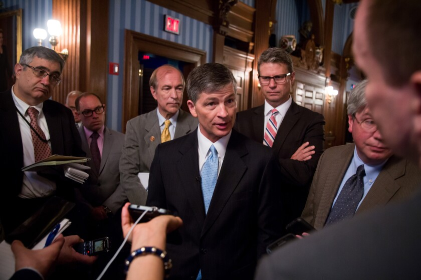 Representative Jeb Hensarling, a Republican from Texas and chairman of the House Financial Services Committee, center, speaks to the media after unveiling the Financial Choice Act June 7, 2016 Bloomberg News