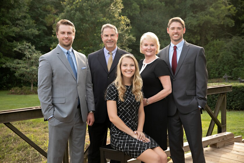 The Huggins Winders Group are based in a new location for Stifel in Tallahassee, Florida. It's the firm's 22nd branch in the state. From left to right: Blair Huggins, Stephen Huggins, Erin Lofy, Linda Winders, and JD Huggins.