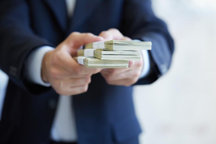 money-in-hands-85865405-adobe.jpeg