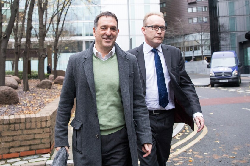 Chris Bush, former U.K. managing director for Tesco Plc,  departs Southwark Crown Court following the dismissal of their accounting-scandal Case in London.