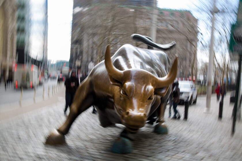 The famous bull sculpture stands near Wall Street in New York, U.S., on Friday, Feb. 12, 2016. U.S. stocks halted a five-day slide that dragged global equities into a bear market, as oil rebounded from a 12-year low and bank shares surged. Photographer: Michael Nagle/Bloomberg