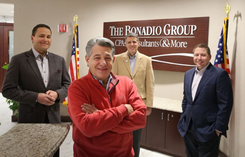 The Bonadio Group's Management Committee: (left to right) Rochester office managing partner Bruce Zicari, CEO Thomas Bonadio, chairman and Buffalo office managing partner Mario Urso, COO Robert Enright