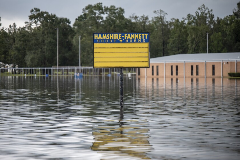 Flood water surrounds a sign for Hamsire-Fannett High School following Tropical Storm Imelda in Fannett, Texas, U.S., on Friday, Sept. 20, 2019. The remnants of Tropical Storm Imelda lashed Houston and coastal Texas, inundating homes, paralyzing travelers, disrupting oil supplies, and threatening hospitals and refineries. Photographer: Sergio Flores/Bloomberg