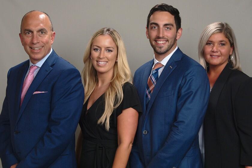 Raymond James team advisors Thomas O'Neill, Jessica O'Neill, CFP®, and Thomas O'Neill Jr., Danielle Takacs (client relationship associate)