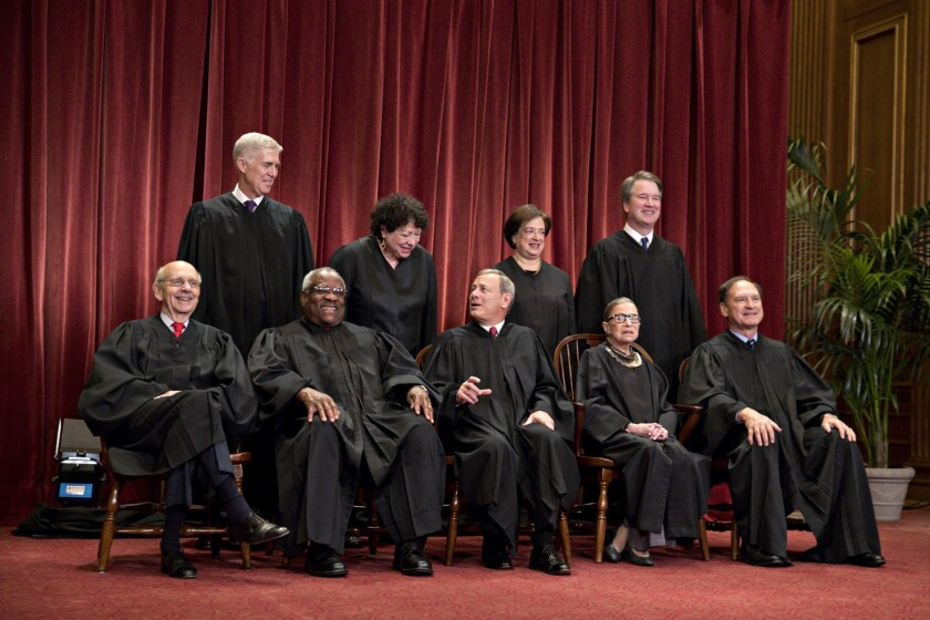 Justices of the U.S. Supreme Court pose during their formal group photograph in the East Conference Room of the Supreme Court in Washington, D.C., U.S. Seated from left: Associate Justice Stephen Breyer, Associate Justice Clarence Thomas, Chief Justice John Roberts, Associate Justice Ruth Bader Ginsburg and Associate Justice Samuel Alito Jr. Standing behind from left: Associate Justice Neil Gorsuch, Associate Justice Sonia Sotomayor, Associate Justice Elena Kagan and Associate Justice Brett Kavanaugh.