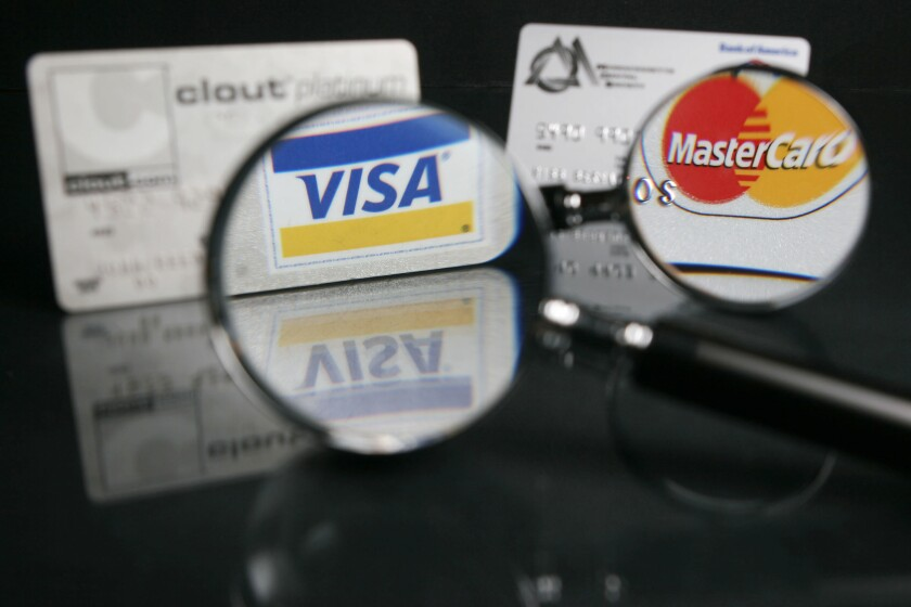 Visa, Mastercard cards under the magnifying glass