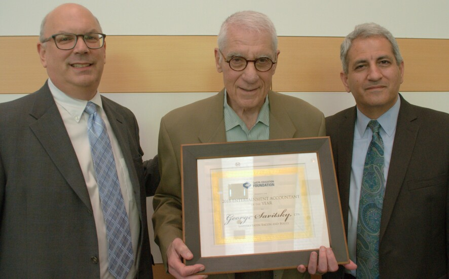 George Savitsky, CPA , of the Beverly Hills firm of Savitsky Satin Bacon Bucci, accepts the Entertainment Accountant of the Year Award from Bill Harris (left) and Ilan Haimoff, co-chairs of the annual CalCPA Education Foundation Entertainment Industry Conference on June 20.