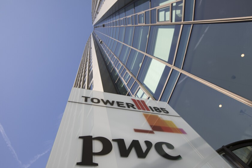 The PricewaterhouseCoopers LLP logo sits on a sign outside 51-storey skyscraper Tower 185 in Frankfurt, Germany.
