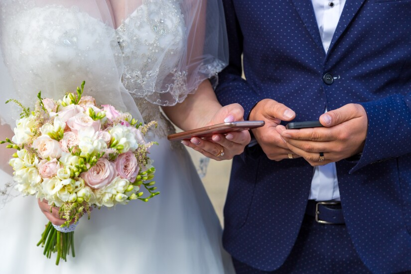 Bride and groom with phones