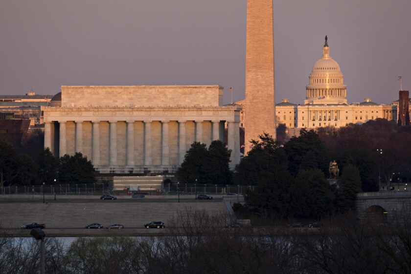 The Lincoln Memorial, from left, Washington Monument and U.S. Capitol at sunset in Washington, D.C.