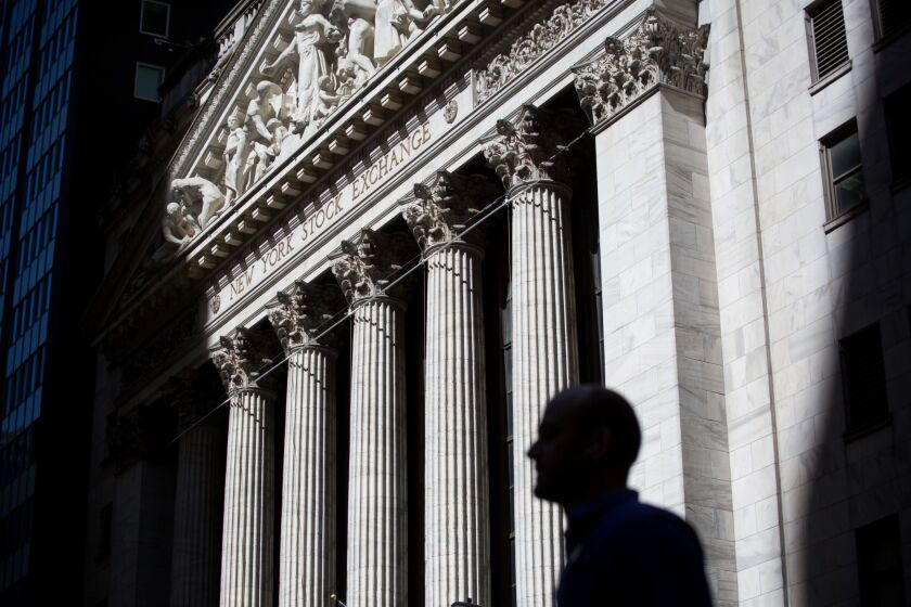 A pedestrian passes in front of the New York Stock Exchange (NYSE) in New York, U.S., on Friday, May 24, 2019. U.S. equities climbed at the end of a bruising week in which escalating trade tensions dominated markets. Photographer: Michael Nagle/Bloomberg