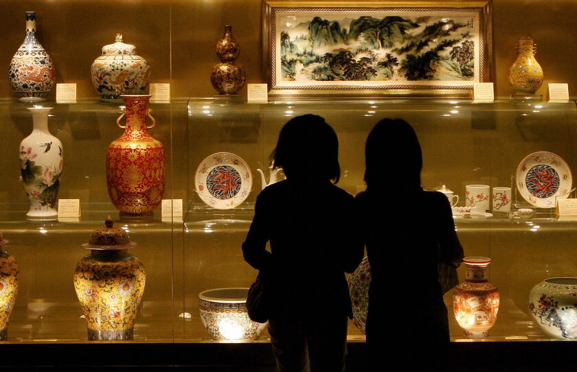 Visitors view a display of Chinese antiques at a preview day for the Millionaire Fair in Shanghai.