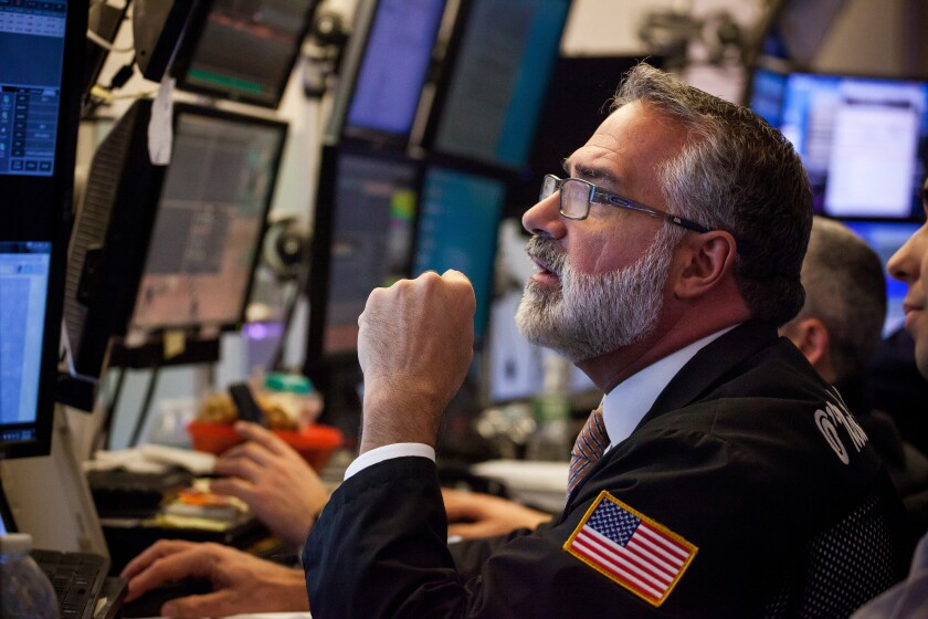 bearded stock exchange trader Bloomberg News
