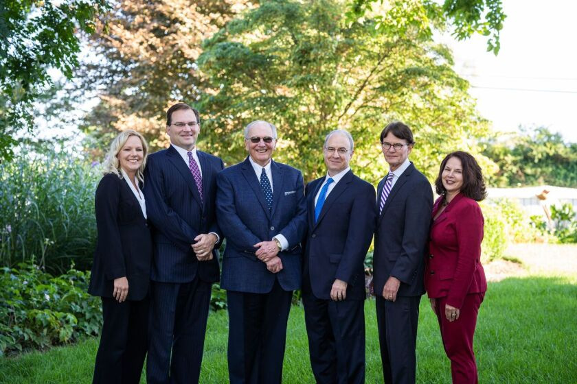Advisors Asa Graves (second from left), his father A. Wesley Graves (middle left) and Douglas Light (second from right) left Wells Fargo to launch their own RIA. Joining them as a founding partner is attorney Jeffrey Lenhart (middle right). Also moving with the team are senior client associates Kara Morgan (far left) and Angela Moats (far right).