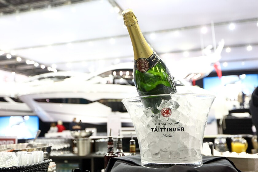 A bottle of Taittinger champagne sits in a bucket of ice at the London Boat Show in London, U.K., on Friday, Jan. 6, 2017. Boats are getting greener, lightweight materials such as composites and glass make for sleeker designs and more efficient fuel consumption, Boat International magazine Chief Executive Officer Tony Harris said during an interview. Photographer: Chris Ratcliffe/Bloomberg