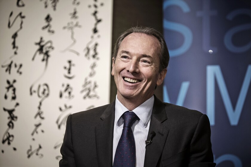 Gorman_James_Morgan_Stanley_CEO_smiling_at_China_conference_Bloomberg_News.jpg