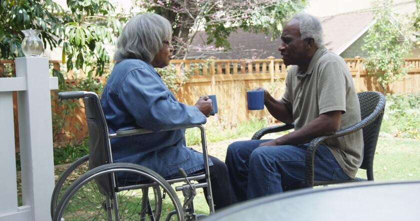 elderly couple old couple wheelchair coffee diverse couple diversity Dec. 14 Adobe Stock