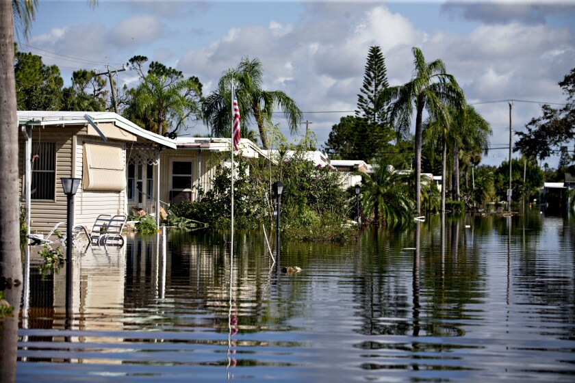 Mobile homes stand in a flooded neighborhood in Bonita Springs, Florida, after Hurricane Irma.