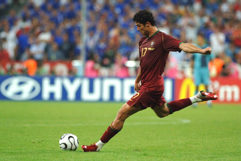 Cristiano Ronaldo of Portugal takes a free kick during the 2006 FIFA World Cup in Munich, Germany.