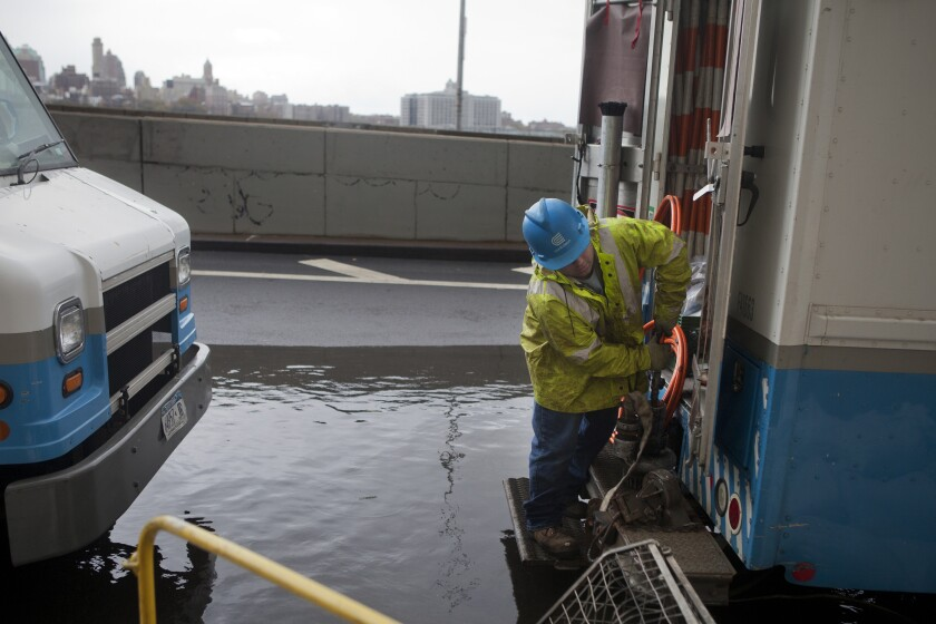 A Con Edison worker tries to get a pump working in Lower Manhattan the day after Hurricane Sandy