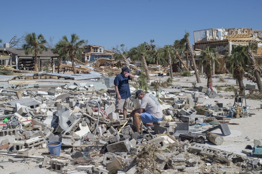 Residents survey debris after Hurricane Michael hit in Mexico Beach, Florida, U.S., on Friday, Oct. 12, 2018.