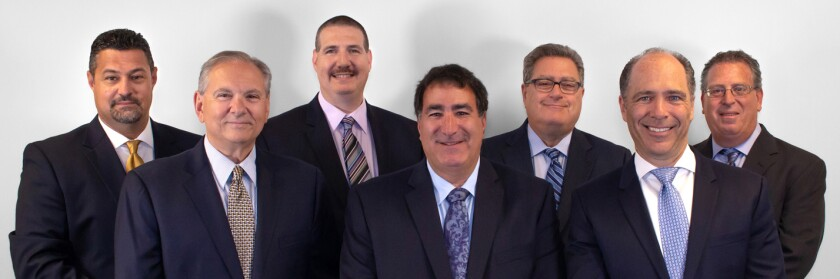 Front row (left to right): Anthony J. Viola, Randy Sofferman and Kenneth Lipner. Back row: Robert J. Mauro, Michael D. Katz, Eliot H. Lebenhart and Jay Lipner.