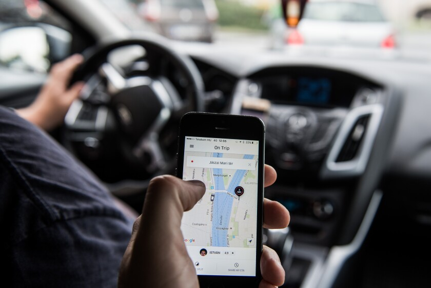 Uber app driver car-sharing by Bloomberg News