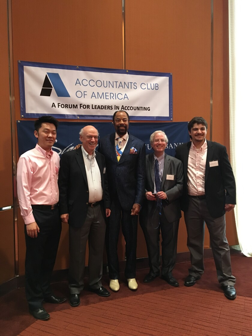 Walt Frazier at the Accountants Club of America,  posing with Bin Qu (left) and Edward Mendlowitz of WithumSmith+Brown, Michael Cohn of Accounting Today, and Robert Reynolds of WithumSmith+Brown.