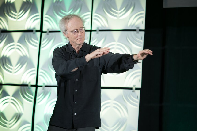 George Kinder, former financial planner and president of the Kinder Institute, says mindfulness is crucial for better client relations. He began a keynote session at a recent FPA conference by performing Tai chi, and led the 460 attendees in a meditation.  Credit: FPA/Jensen Sutta Photography