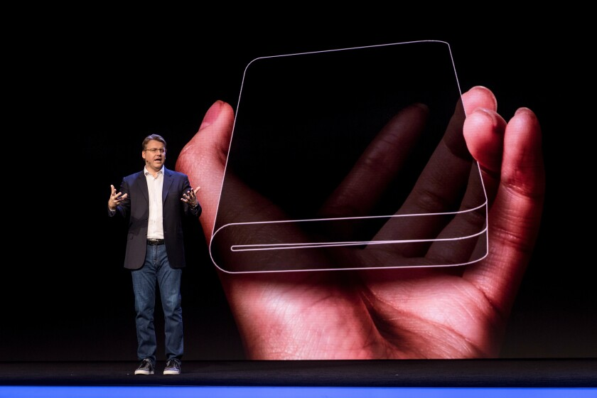 Justin Denison, senior vice president of product strategy and marketing for Samsung Electronics America, shows off a new phone with a foldable screen during the Samsung Developers Conference in San Francisco in early November 2018.