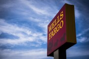Blue Sky. Signage stands outside a Wells Fargo & Co. bank branch in Evanston, Illinois, U.S., on Tuesday, July 10, 2018. Wells Fargo & Co. is scheduled to release earnings figures on July 13.