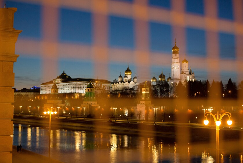 The buildings of the Kremlin complex beside the Moskva River in Moscow